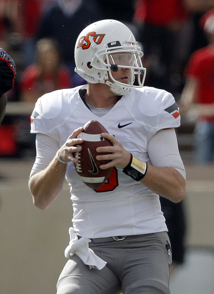 Photo - Oklahoma State's Brandon Weeden (3) looks to throw a pass during a college football game between Texas Tech University (TTU) and Oklahoma State University (OSU) at Jones AT&T Stadium in Lubbock, Texas, Saturday, Nov. 12, 2011.  Photo by Sarah Phipps, The Oklahoman  ORG XMIT: KOD