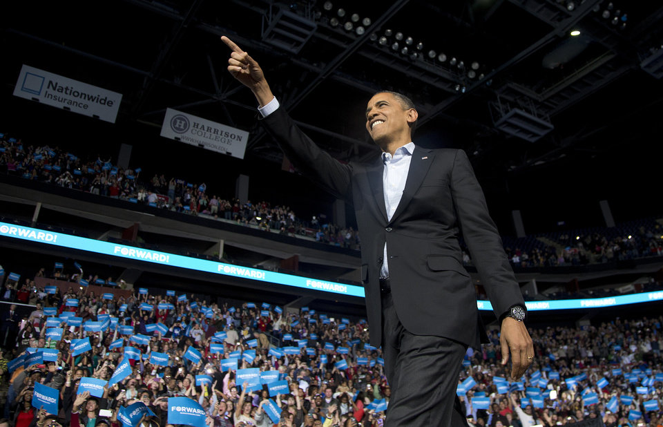 Photo -   President Barack Obama points to the crowd as he arrives to speak at a campaign event at Nationwide Arena, Monday, Nov. 5, 2012, in Columbus, Ohio. (AP Photo/Carolyn Kaster)