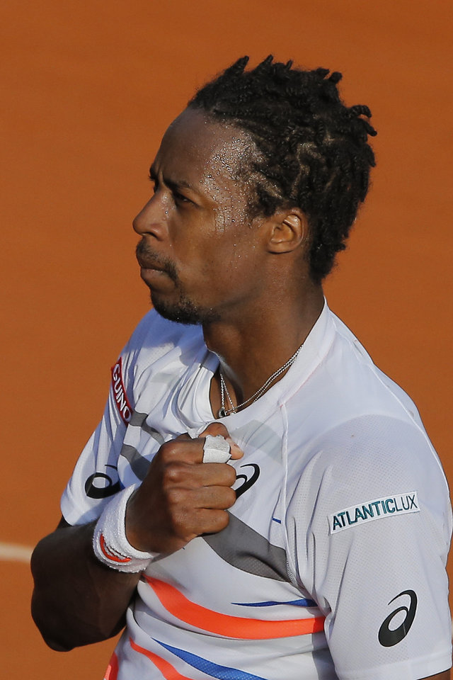 Photo - France's Gael Monfils celebrates winning the fourth round match of the French Open tennis tournament against Spain's Guillermo Garcia-Lopez at the Roland Garros stadium, in Paris, France, Monday, June 2, 2014. Monfils won in three sets 6-0, 6-2, 7-5. (AP Photo/Michel Spingler)