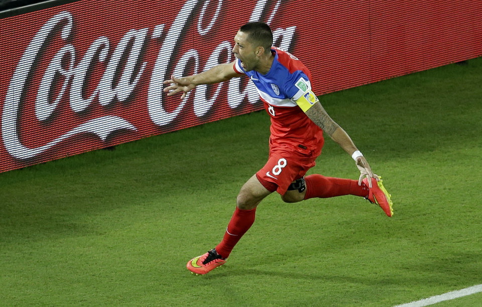 Photo - United States' Clint Dempsey celebrates scoring the opening goal during the group G World Cup soccer match between Ghana and the United States at the Arena das Dunas in Natal, Brazil, Monday, June 16, 2014. (AP Photo/Hassan Ammar)