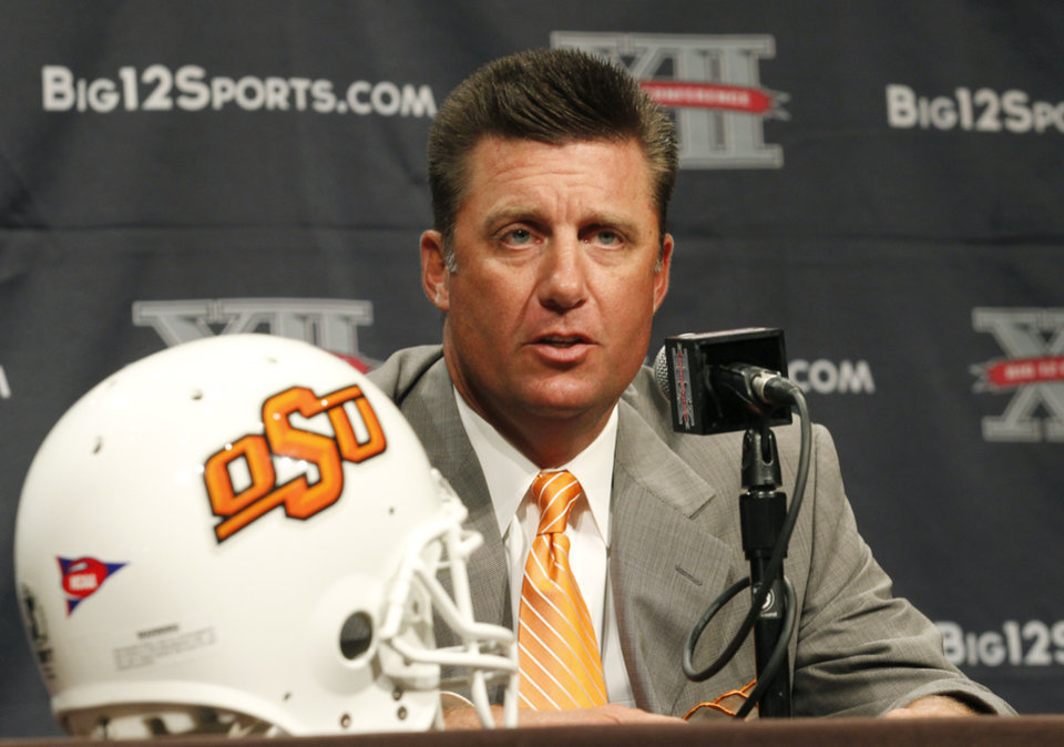 Oklahoma State University football coach Mike Gundy addresses the media at the beginning of the Big 12 Conference Football Media Days Monday, July 22, 2013 in Dallas.  (AP Photo/Tim Sharp)