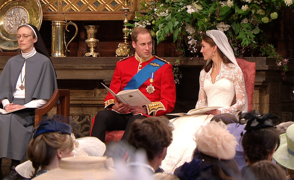 Photo - In this image taken from video, Britain's Prince William, center, looks at his wife, Kate, the Dutchess of Cambridge, at Westminster Abbey for the Royal Wedding in London on Friday, April, 29, 2011. (AP Photo/APTN) EDITORIAL USE ONLY NO ARCHIVE PHOTO TO BE USED SOLELY TO ILLUSTRATE NEWS REPORTING OR COMMENTARY ON THE FACTS OR EVENTS DEPICTED IN THIS IMAGE ORG XMIT: RWVM182