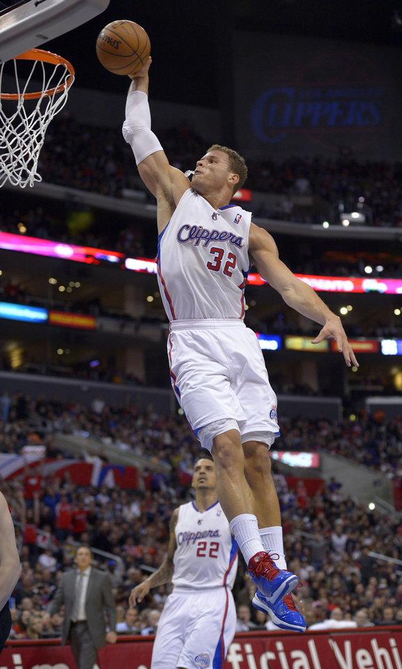 Photo - Los Angeles Clippers forward Blake Griffin, right, goes up for a dunk as forward Matt Barnes looks on during the first half of an NBA basketball game against the Portland Trail Blazers, Sunday, Jan. 27, 2013, in Los Angeles. (AP Photo/Mark J. Terrill)