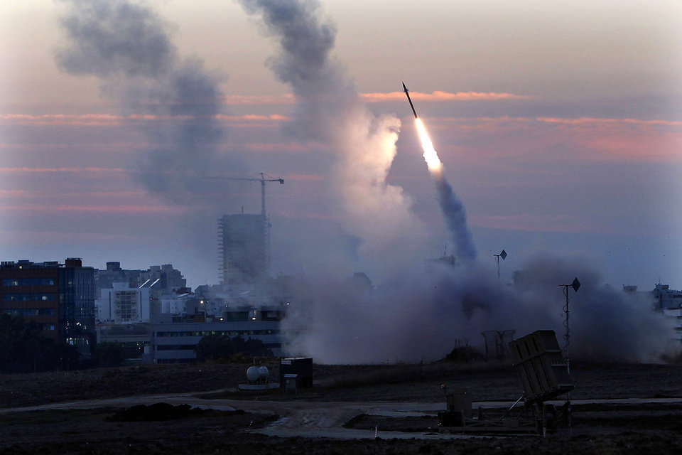 The Iron Dome defense system fires to interecpt incoming missiles from Gaza in the port town of Ashdod, Thursday, Nov. 15, 2012. Israel�s prime minister Benjamin Netanyahu said Thursday that the army is prepared for a �significant widening� of its operation in the Gaza Strip. (AP Photo /Tsafrir Abayov)