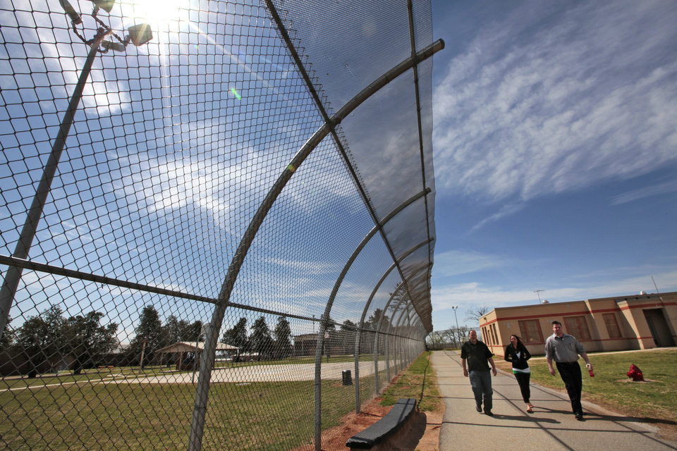 Photo - This overhanging fence is at the Central Oklahoma Juvenile Center in Tecumseh where many changes have been made in the effort to improve the facility. Photo by David McDaniel, The Oklahoman  David McDaniel