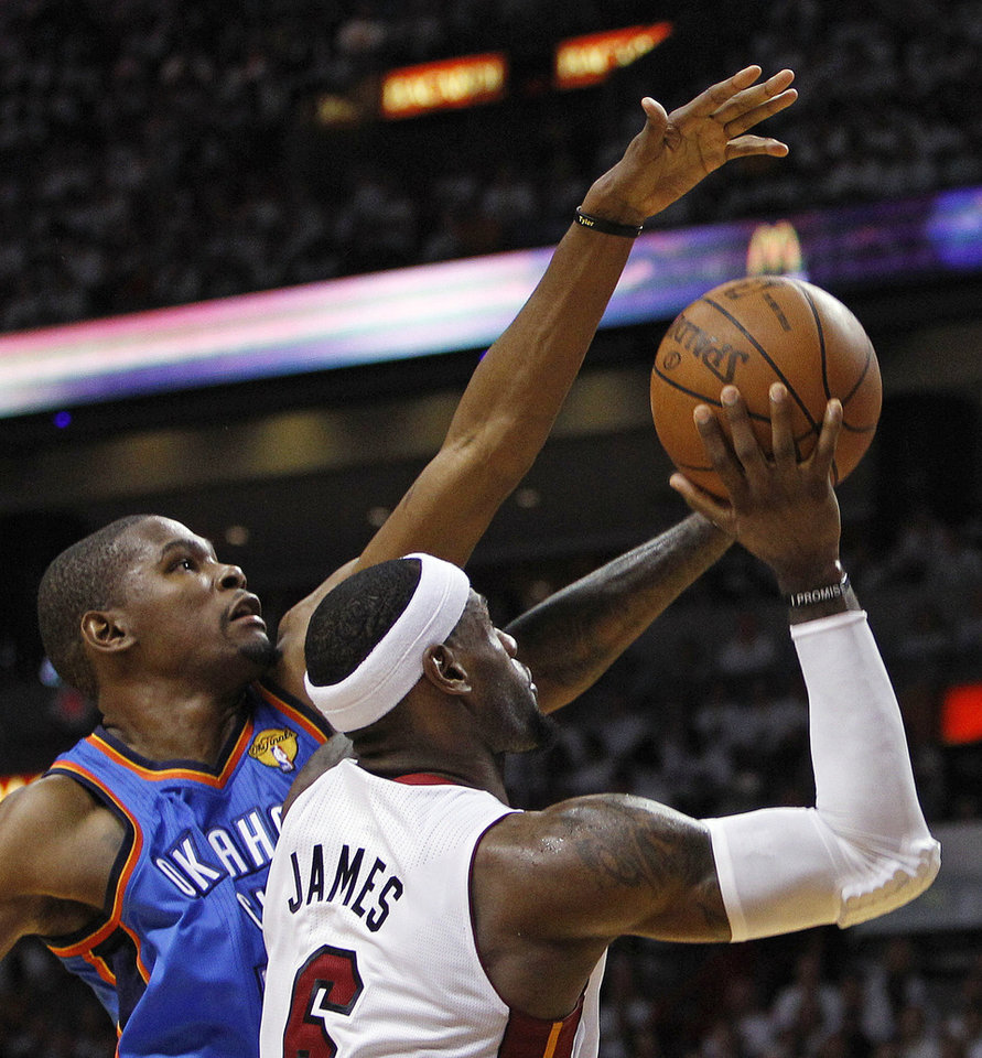 Photo - Miami Heat small forward LeBron James (6) shoots as Oklahoma City Thunder small forward Kevin Durant (35) defends during the first half at Game 3 of the NBA Finals basketball series, Sunday, June 17, 2012, in Miami. (AP Photo/Lynne Sladky) ORG XMIT: NBA119