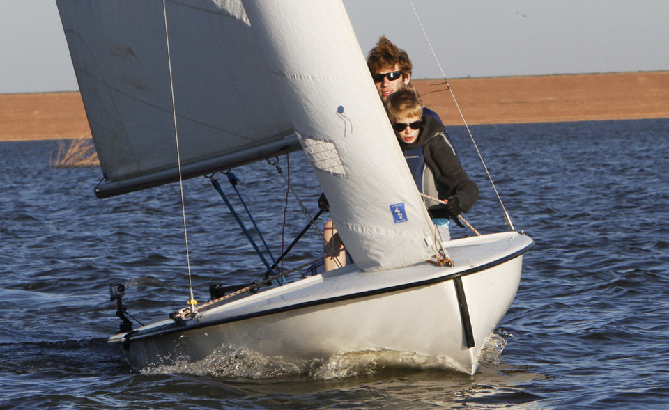 Junior Tayler Boerner and freshman Sarah Brown sail a Collegiate 420 sailboat during practice at Lake Arcadia for the UCO Sailing Club, Monday, October 31, 2011.       Photo by David McDaniel, The Oklahoman