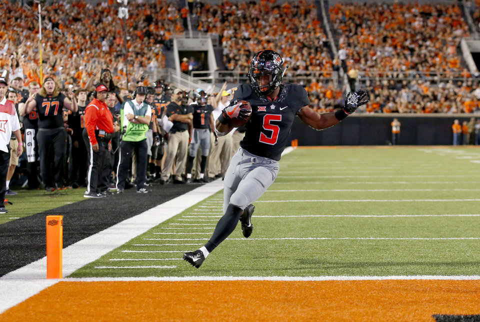 Photo - Oklahoma State's Justice Hill (5) scores a  touchdown in the second quarter  during a college football game between Oklahoma State (OSU) and South Alabama at Boone Pickens Stadium in Stillwater, Okla., Saturday, Sept. 8, 2018. Photo by Sarah Phipps, The Oklahoman