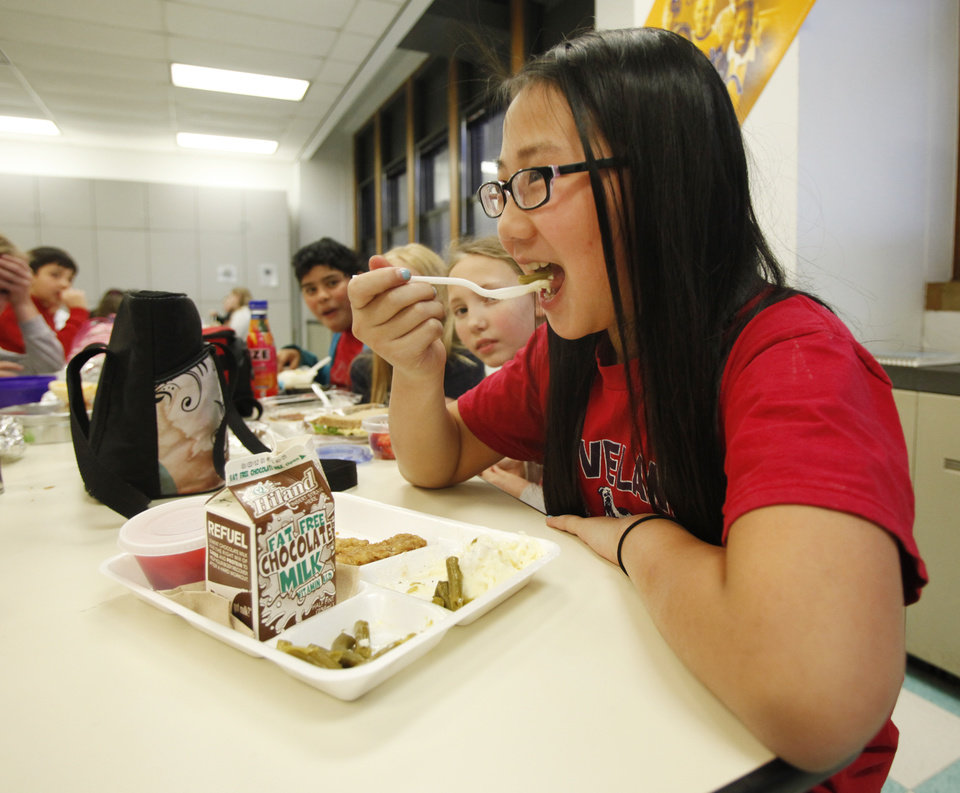 Maggie Bui, fifth grade, eats her Made In Oklahoma lunch at Cleveland Elementary School in Oklahoma City, Thursday  January , 05,  2012. Photo by Steve Gooch, The Oklahoman
