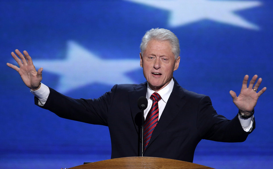 Photo - Former President Bill Clinton addresses the Democratic National Convention in Charlotte, N.C., on Wednesday, Sept. 5, 2012. (AP Photo/J. Scott Applewhite)  ORG XMIT: DNC178