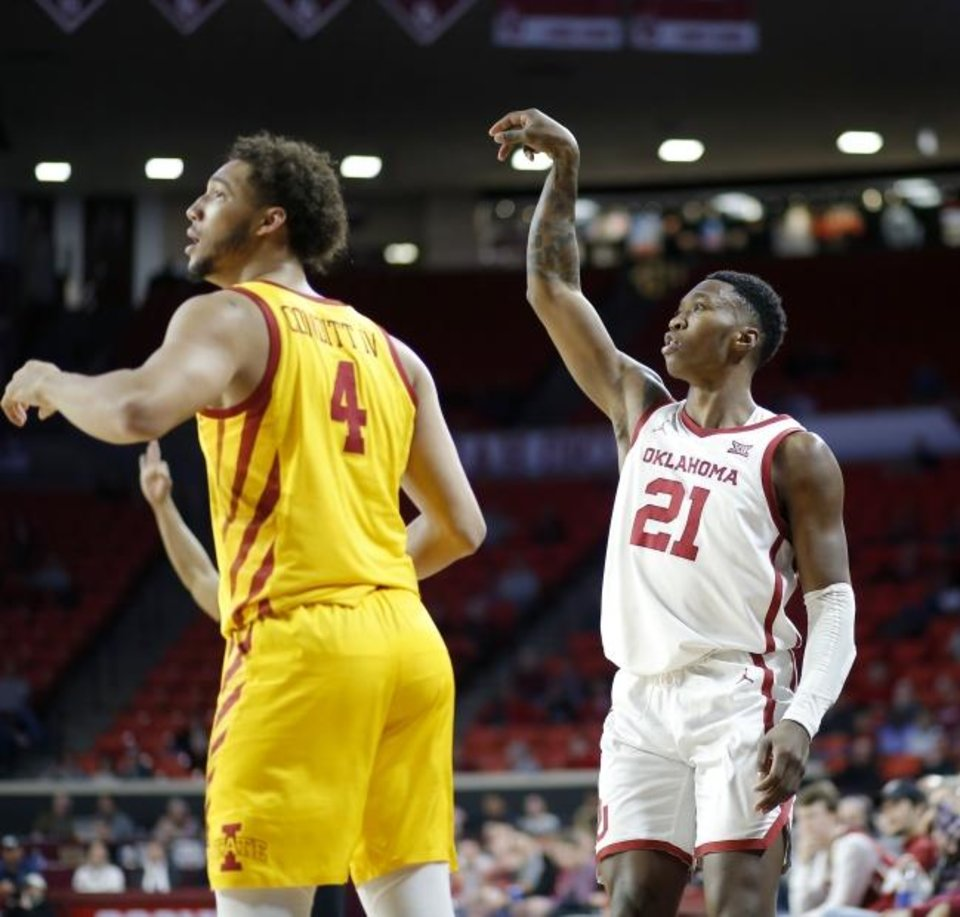 Photo -  Oklahoma's Kristian Doolittle, right, watches his shot go in the basket next to Iowa State's George Conditt IV on Wednesday night at Lloyd Noble Center. [Bryan Terry/The Oklahoman]