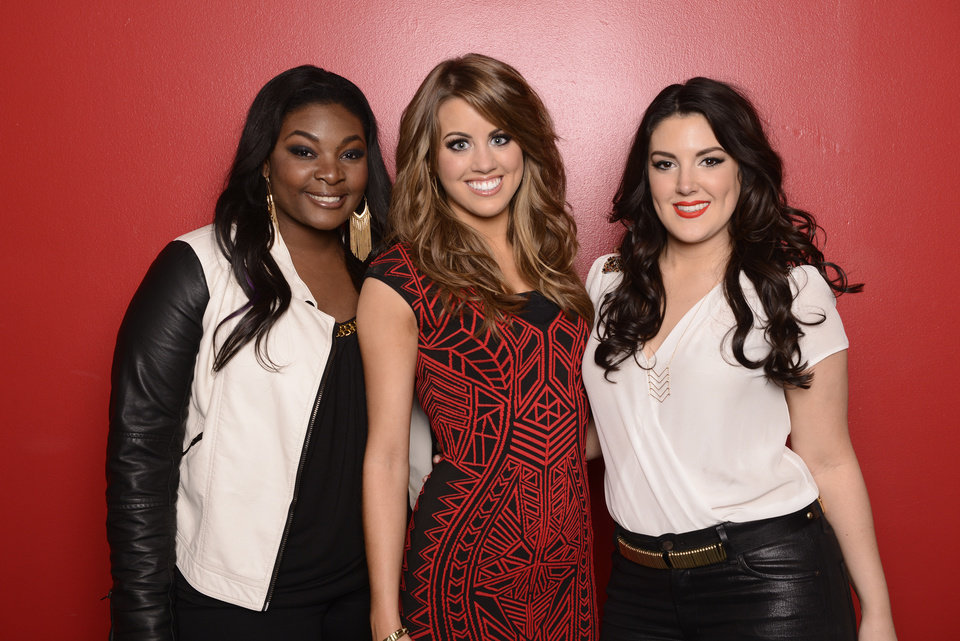 Photo - This May 2, 2013 photo released by Fox shows, from left, Candice Glover, Angie Miller and Kree Harrison, finalists in the singing competition series