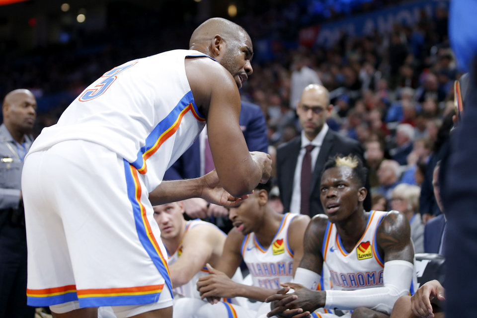 Photo - Oklahoma City's Chris Paul (3) talks with teammates during a timeout in an NBA basketball game between the Oklahoma City Thunder and the Dallas Mavericks at Chesapeake Energy Arena in Oklahoma City, Tuesday, Dec. 31, 2019. Oklahoma City won 106-101. [Bryan Terry/The Oklahoman]