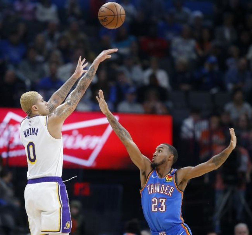 Photo -  Los Angeles' Kyle Kuzma (0) shoots a basket over Oklahoma City's Terrance Ferguson (23) during Saturday night's game. Kuzma scored 36 points in the Lakers 125-110 win. [Bryan Terry/The Oklahoman]