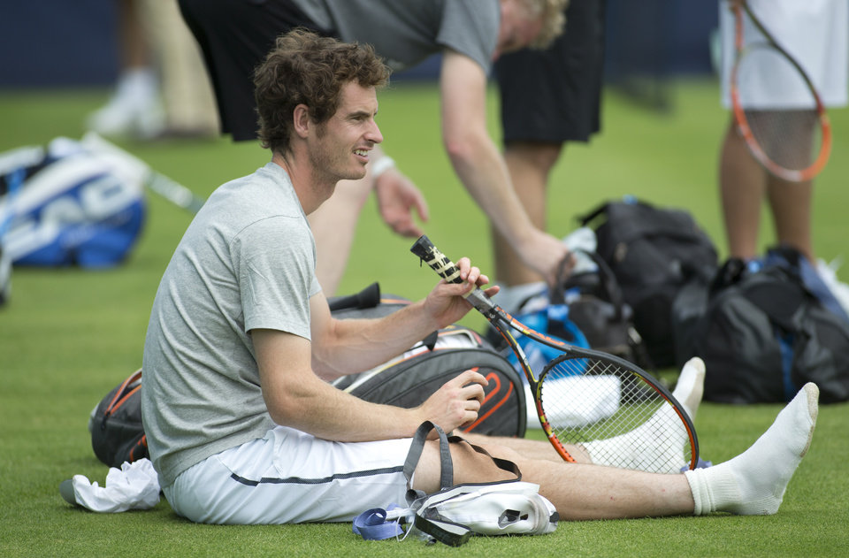 Photo - Britain's Andy Murray takes part in a training session for the Queen's Club grass court tennis tournament in London, Monday June, 9, 2014. Murray plays Wednesday. (AP Photo/Alastair Grant)