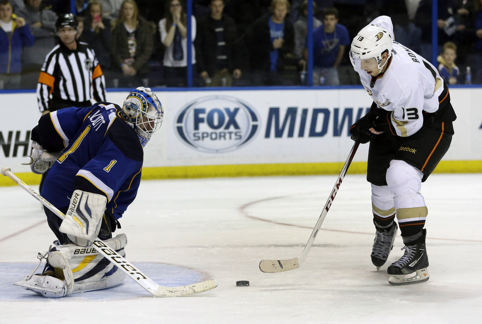 Anaheim Ducks\' Nick Bonino, right, scores the game-winning goal past St. Louis Blues goalie Brian Elliott during the shootout in an NHL hockey game Saturday, Feb. 9, 2013, in St. Louis. The Ducks won 6-5. (AP Photo/Jeff Roberson)