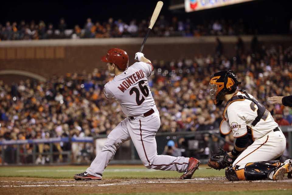 Photo - Arizona Diamondbacks' Miguel Montero (26) drives in two runs with a double against the San Francisco Giants during the third inning of a baseball game on Thursday, April 10, 2014, in San Francisco. (AP Photo/Marcio Jose Sanchez)