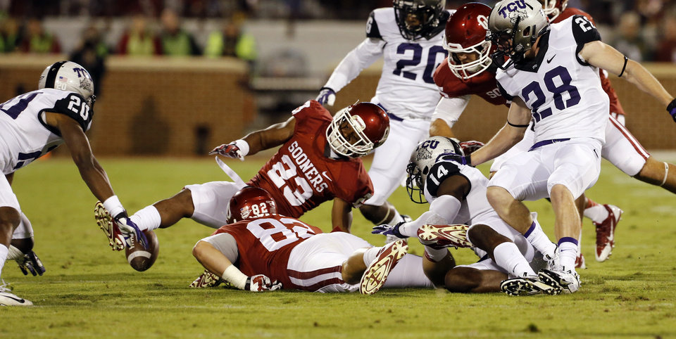 Photo - TCU recovers an kickoff during the second half of a college football game between the University of Oklahoma Sooners (OU) and the TCU Horned Frogs at Gaylord Family-Oklahoma Memorial Stadium in Norman, Okla., on Saturday, Oct. 5, 2013. Photo by Steve Sisney, The Oklahoman