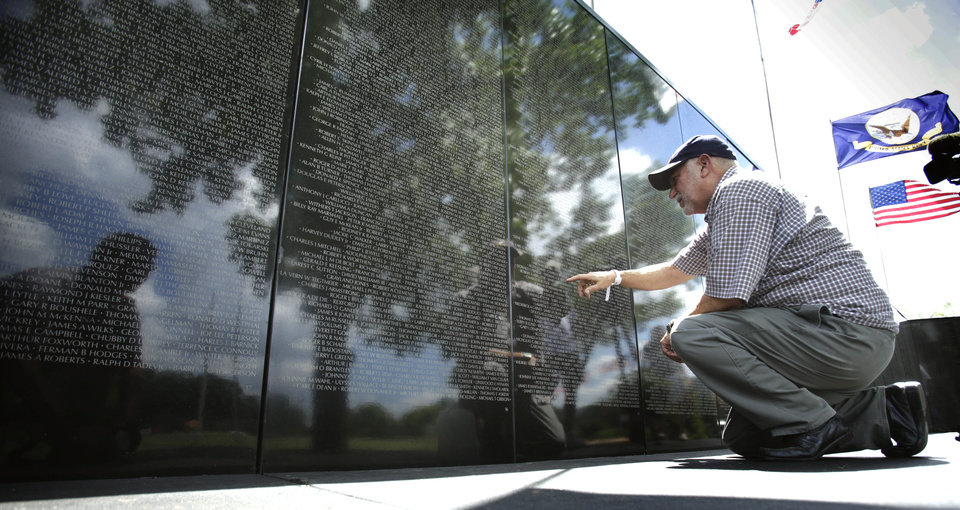 Bill Albin of Red Oak looks for the names of acquaintances on the Dignity Vietnam Memorial Wall on Wednesday, June 30, 2010, in Norman Okla.   Photo by Steve Sisney, The Oklahoman