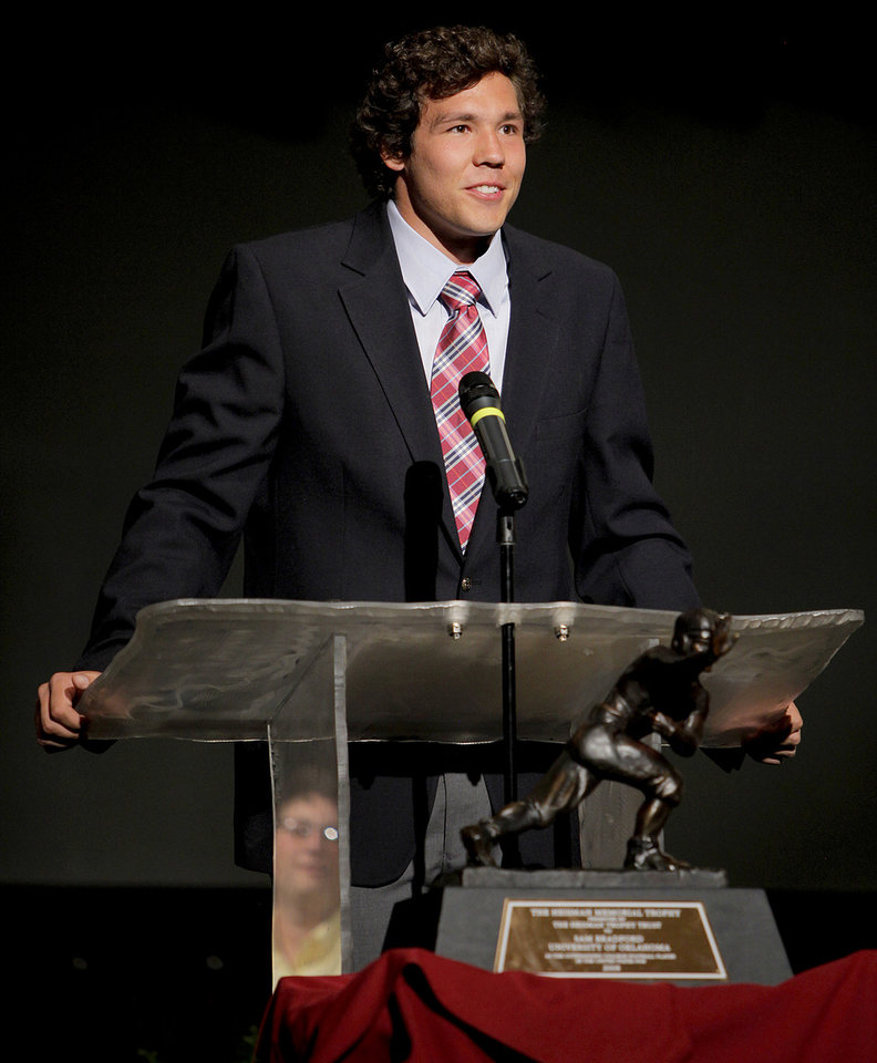 Photo - JERSEY RETIREMENT: University of Oklahoma (OU) college football quarterback Sam Bradford speaks during a ceremony to honor him and retire his jersey at Putnam City North High School in Oklahoma City, Friday, April 24, 2009. Photo by Bryan Terry, The Oklahoman ORG XMIT: KOD