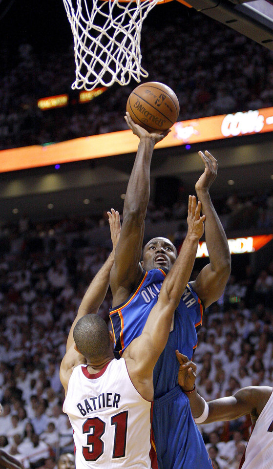Photo - Oklahoma City's Serge Ibaka (9) shoots over Miami's Shane Battier (31) during Game 5 of the NBA Finals between the Oklahoma City Thunder and the Miami Heat at American Airlines Arena, Thursday, June 21, 2012. Photo by Bryan Terry, The Oklahoman