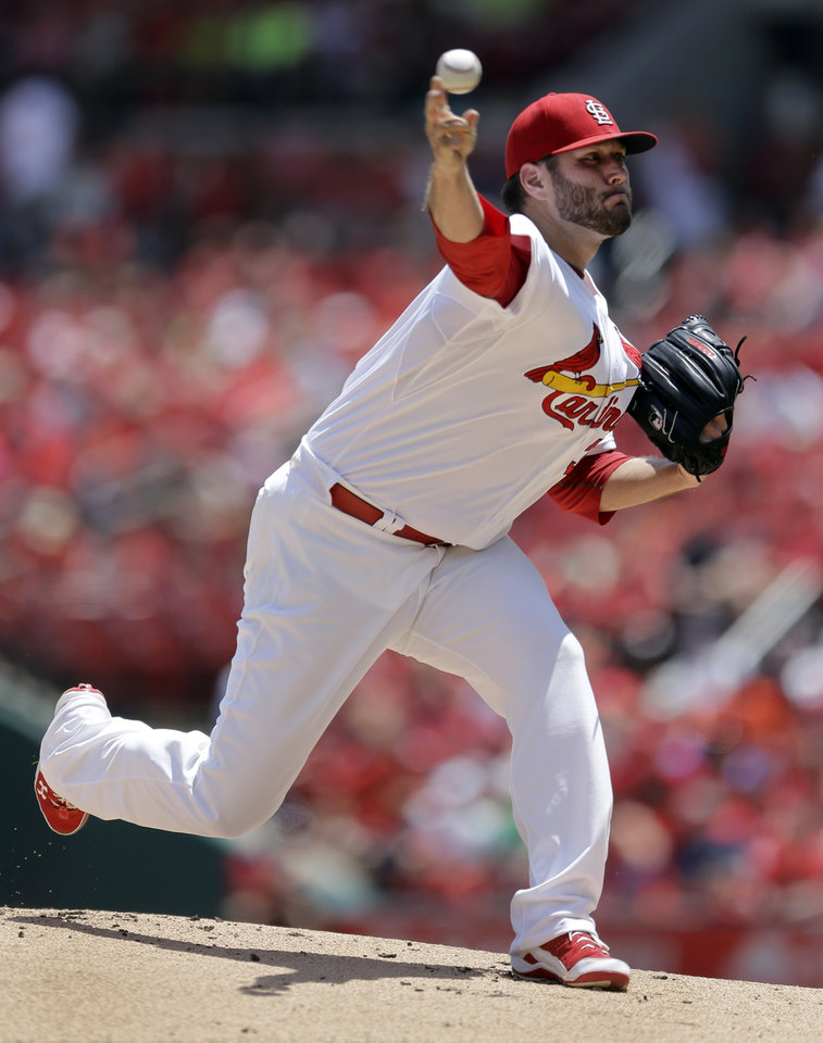 Photo - St. Louis Cardinals starting pitcher Lance Lynn throws during the first inning of a baseball game against the New York Mets Wednesday, June 18, 2014, in St. Louis. (AP Photo/Jeff Roberson)