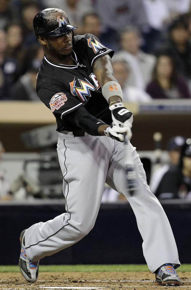 Photo -   Miami Marlins' Hanley Ramirez swings during an at-bat in the second inning against the San Diego Padres during their baseball game, Friday, May 4, 2012, in San Diego. (AP Photo/Gregory Bull)