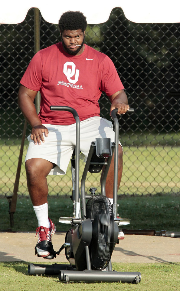 Photo - Defensive tackle Jordan Phillips is sidelined during the University of Oklahoma Sooners (OU) football practice at the rugby fields in Norman, Okla., on Tuesday, Aug. 5, 2014. Photo by Steve Sisney, The Oklahoman