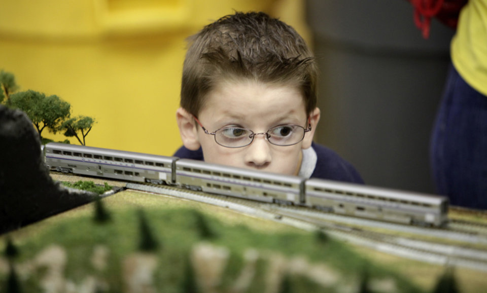Hunter Misenheimer watches a miniature train at the Norman Public Library.