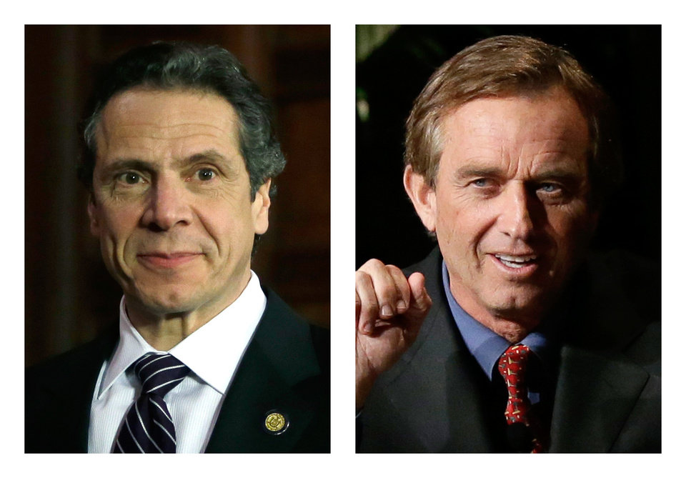 These 2013 file photos show New York Gov. Andrew Cuomo, left, in Albany, N.Y. and Robert F. Kennedy Jr. in Dallas, Texas. People familiar with Cuomo\'s thinking on fracking tell The Associated Press he was on the brink of approving the much-debated gas drilling method in February 2013 but held off after discussions with environmentalist and former brother-in-law, Kennedy. (AP Photo/Tony Gutierrez)