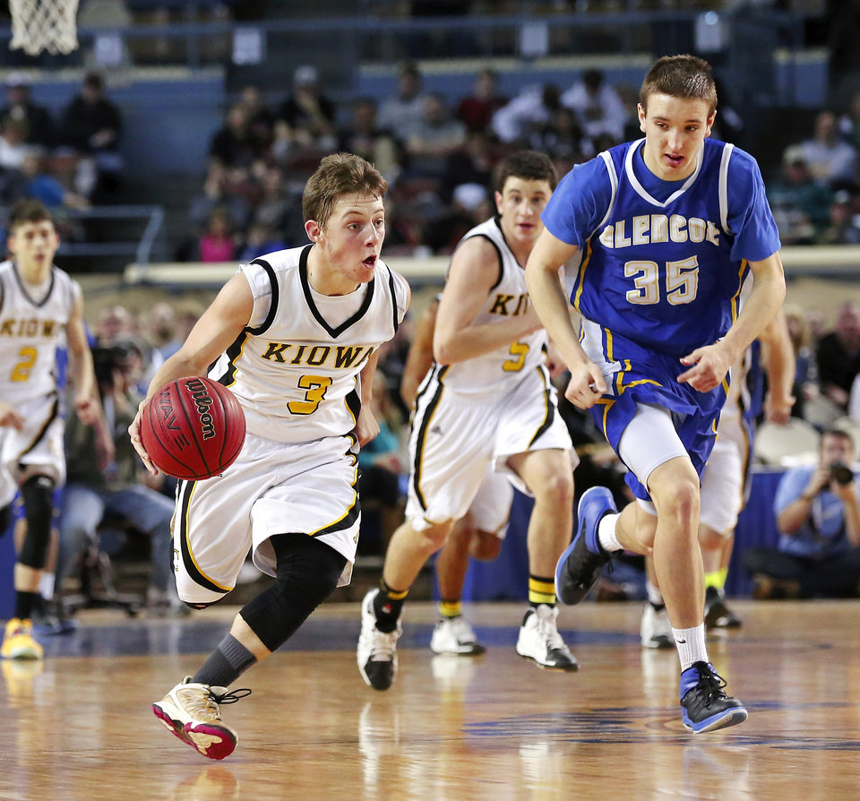 Photo - Kiowa's Clay Doyle hurries down the court in front of Glencoe player Ty Lazenby during Class A boys high school basketball championship game in the Jim Norick Arena at State Fair Park on  Saturday, March 8, 2014. Glencoe defeated Kiowa, 57-39. Photo by Jim Beckel, The Oklahoman