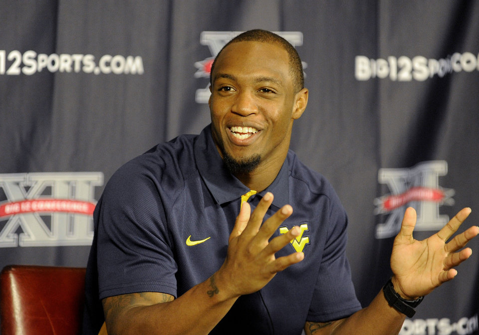 West Virginia wide receiver Tavon Austin gestures at NCAA college football Big 12 Media Days, Tuesday, July 24, 2012, in Dallas. (AP Photo/Matt Strasen)