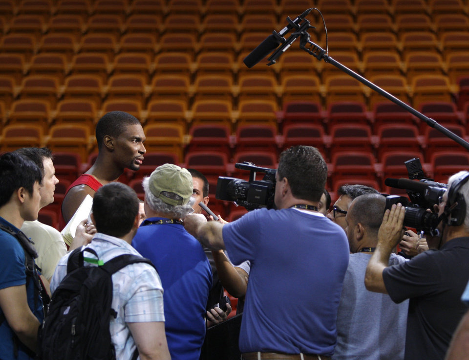 Miami\'s Chris Bosh is surrounded by media after a practice before Game 4 of the NBA Finals between the Oklahoma City Thunder and the Miami Heat at American Airlines Arena, Monday, June 18, 2012. Photo by Bryan Terry, The Oklahoman