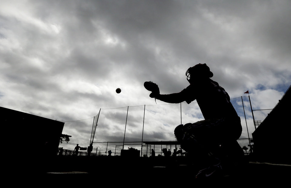 Photo - Philadelphia Phillies catcher Tommy Joseph catches the ball during spring training baseball practice Thursday, Feb. 13, 2014, in Clearwater, Fla. (AP Photo/Charlie Neibergall)