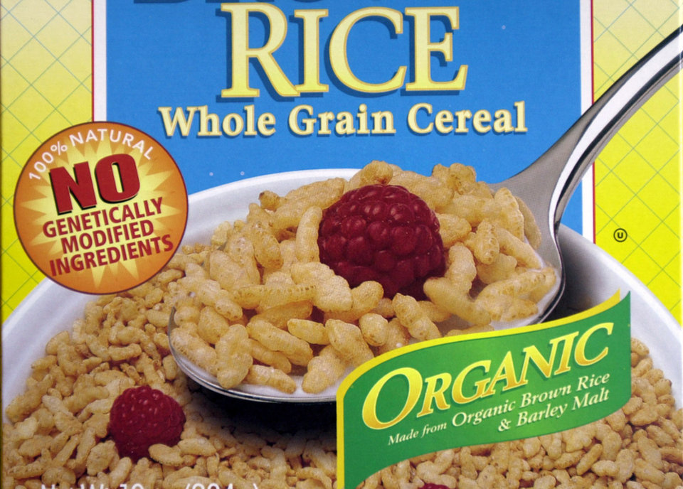 "FILE - This Sept. 30, 2002 file photo shows labeling advertising no genetically engineered ingredients on a box of Erewhon Crispy Brown Rice Cereal in San Francisco. International food and chemical conglomerates are spending millions to defeat Proposition 37, which would require labeling on all food made with altered genetic material. It also would prohibit labeling or advertising such food as ""natural."" (AP Photo/Paul Sakuma, File)"