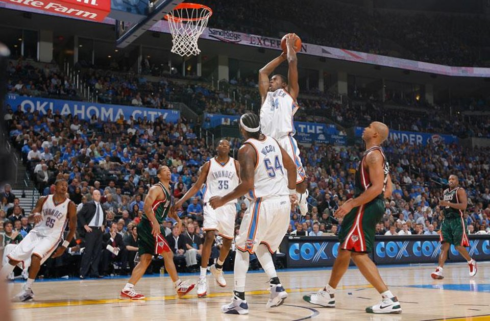 Photo -  Desmond Mason (34) drives to the basket against the Bucks during the opening NBA basketball game between the Oklahoma City Thunder and the Milwaukee Bucks at the Ford Center in Oklahoma City, Wednesday, October 29, 2008.  BY BRYAN TERRY, THE OKLAHOMAN