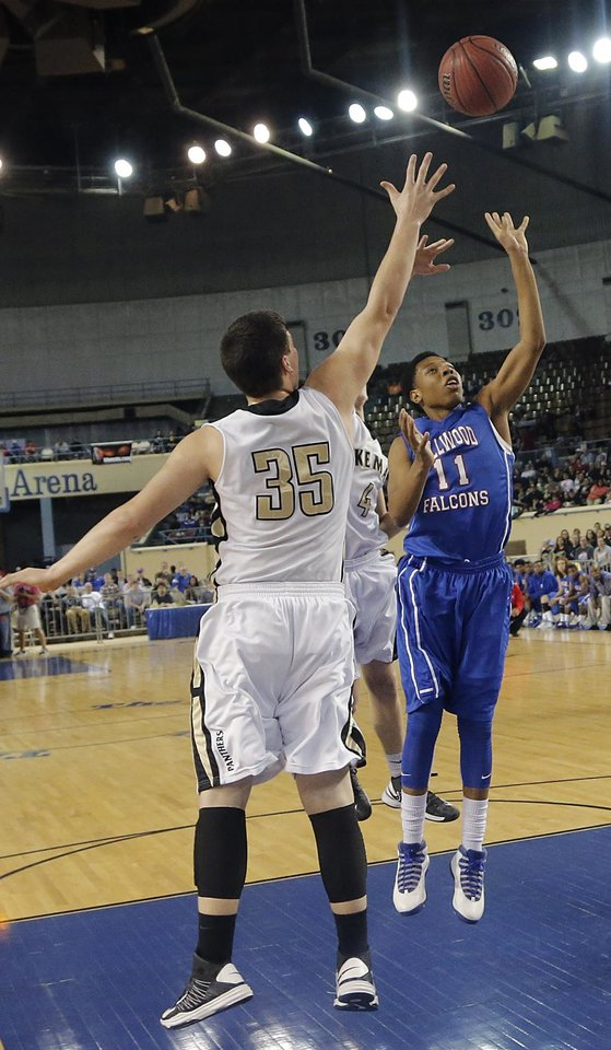 Millwood\'s Michael Mays (11) shoots past Okemah\'s Austin Guinn (35) during the state high school basketball tournament Class 3A boys championship game between Millwood High School and Okemah High School at the State Fair Arena on Saturday, March 9, 2013, in Oklahoma City, Okla. Photo by Chris Landsberger, The Oklahoman
