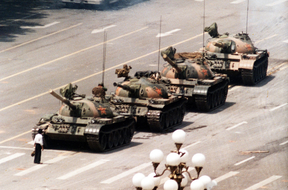 Photo - A Chinese protester blocks a line of tanks heading east on Cangan Boulevard in Beijing on June 5, 1989.  AP PHOTO