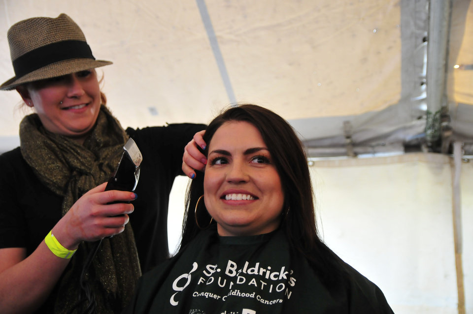 Shelby Blagg nervously waits to get her head shaved during the St. Baldrick's charity event at VZD's Restaurant and Club in Oklahoma City, Okla. Sunday, March 23, 2013.  Photo by Nick Oxford, for The Oklahoman