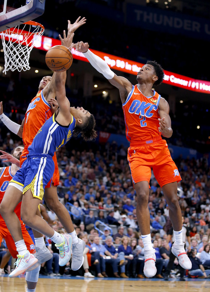 Photo - Oklahoma City's Shai Gilgeous-Alexander (2) and Darius Bazley (7) defend against Golden State's Jordan Poole (3) during the NBA game between the Oklahoma City Thunder and Golden State Warriors at Chesapeake Energy Arena,  Sunday, Oct. 27, 2019. Thunder won 120-92.[Sarah Phipps/The Oklahoman]