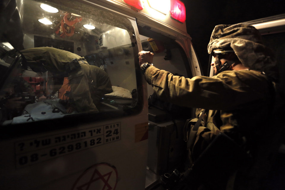 Photo -   A wounded Israeli soldier is evacuated by ambulance on the Israel-Gaza border in southern Israel, Saturday, Nov. 10, 2012. An explosion targeted an Israeli military vehicle on the Jewish state's border with Gaza on Saturday and Israeli troops fired into the Palestinian territory, killing several civilians and wounding at least 25, Gaza officials and witnesses said. (AP Photo/Tsafrir Abayov)