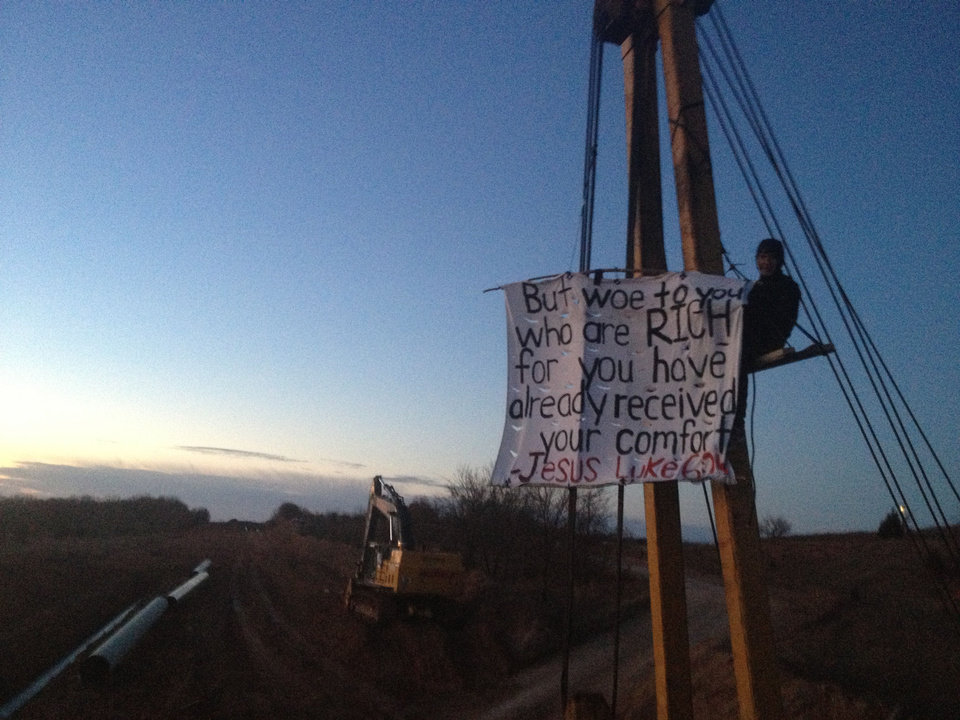 Photo - Stefan Warner protested construction of the Keystone XL pipeline in February by climbing a side boom and chaining himself to a platform near Schoolton in Seminole County. He and seven others subsequently were arrested for trespassing.   - provided