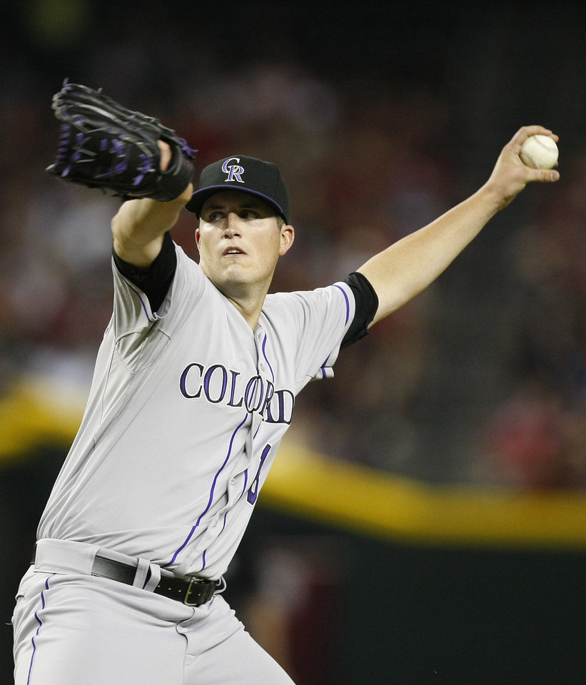 Colorado Rockies starting pitcher Drew Pomeranz  throws in the first inning during a baseball game against the Arizona Diamondbacks on Saturday, July 6, 2013, in Phoenix. (AP Photo/Rick Scuteri)