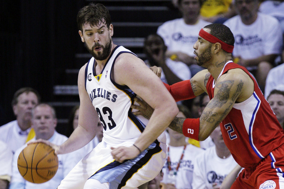 Photo -   Memphis Grizzlies' Marc Gasol (33), of Spain, is defended by Los Angeles Clippers' Kenyon Martin (2) during the first half in Game 1 of a first-round NBA basketball playoff series, Sunday, April 29, 2012, in Memphis, Tenn. (AP Photo/Danny Johnston)