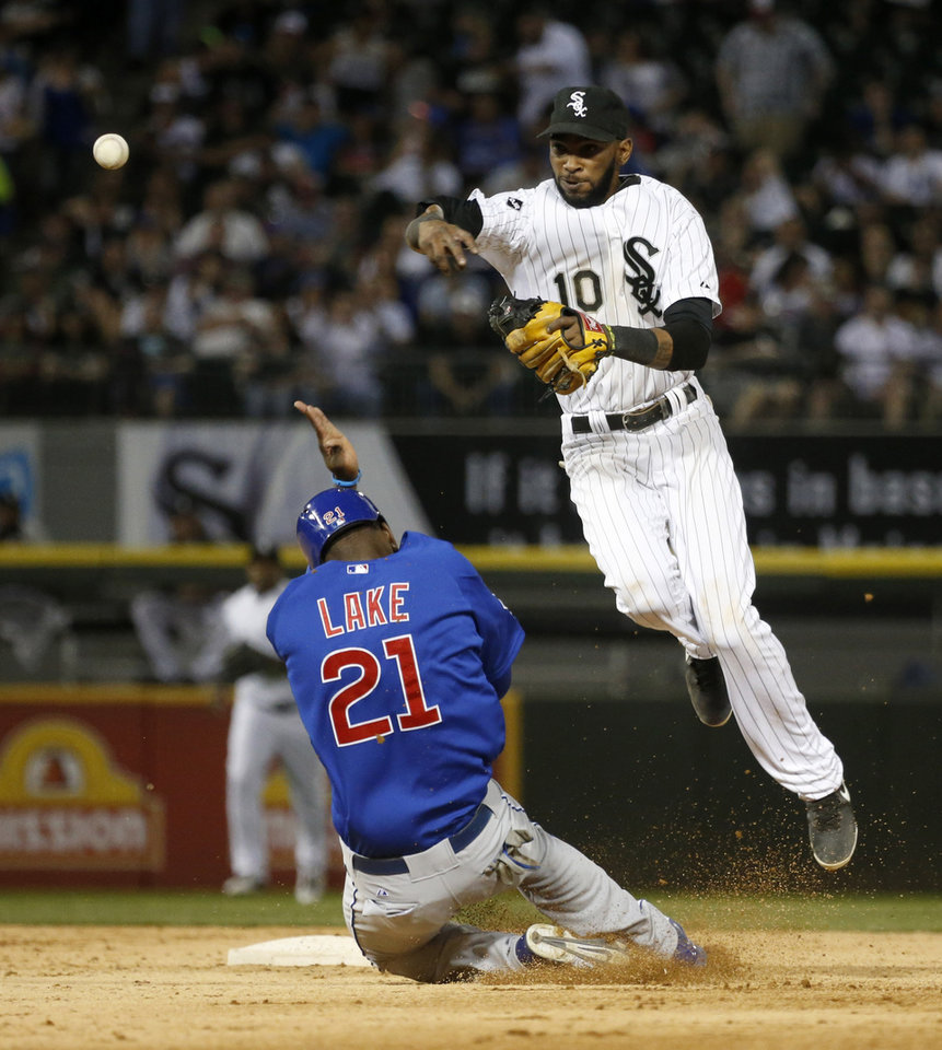 Photo - Chicago Cubs' Junior Lake (21) breaks up a double play after being forced out at second by Chicago White Sox shortstop Alexei Ramirez during the fifth inning of an interleague baseball game Thursday, May 8, 2014, in Chicago. (AP Photo/Charles Rex Arbogast)