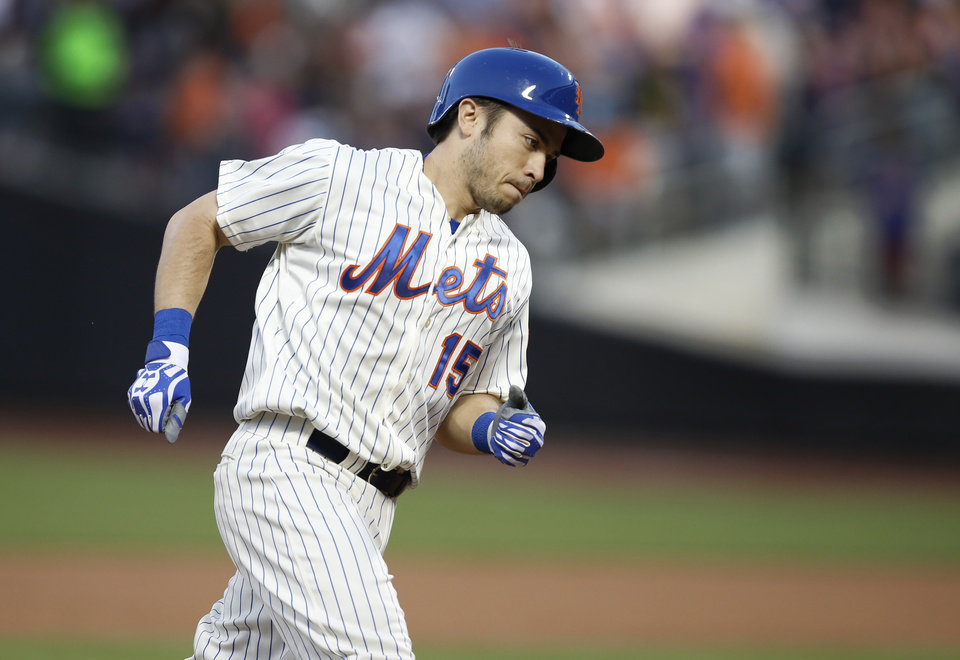 Photo - New York Mets Travis d'Arnaud runs the bases after hitting a third-inning three-run home run off Oakland Athletics starting pitcher Scott Kazmir in an interleague baseball game in New York, Tuesday, June 24, 2014. The Mets defeated the Oakland Athletics 10-1. (AP Photo/Kathy Willens)