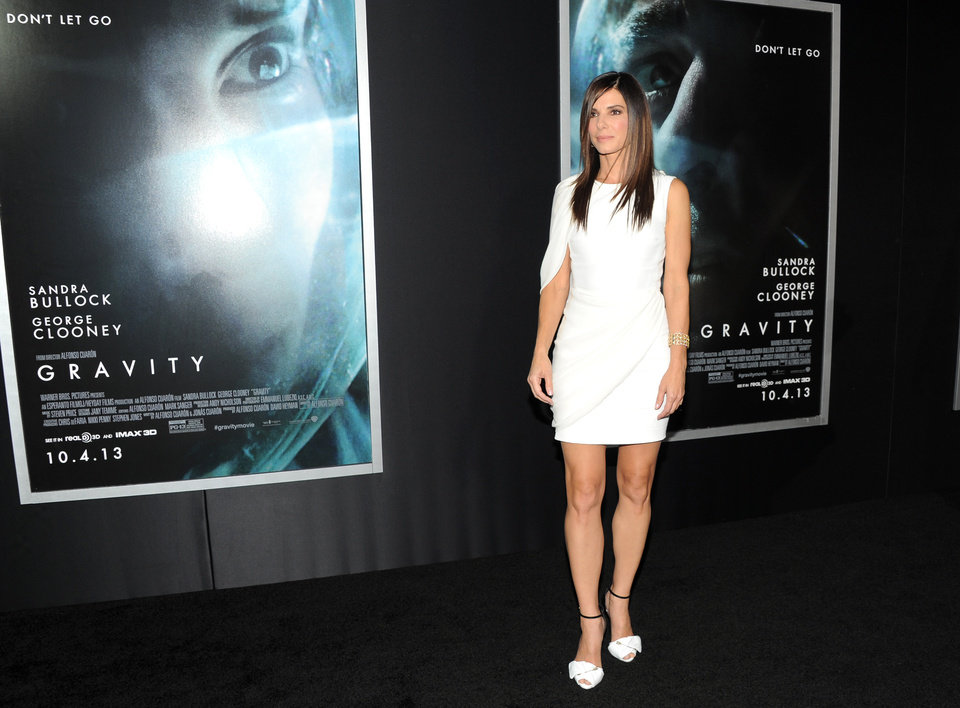 "Photo - Actress Sandra Bullock attends the premiere of ""Gravity"" at the AMC Lincoln Square Theaters on Tuesday, Oct. 1, 2013, in New York. (Photo by Evan Agostini/Invision/AP) ORG XMIT: NYEA107"