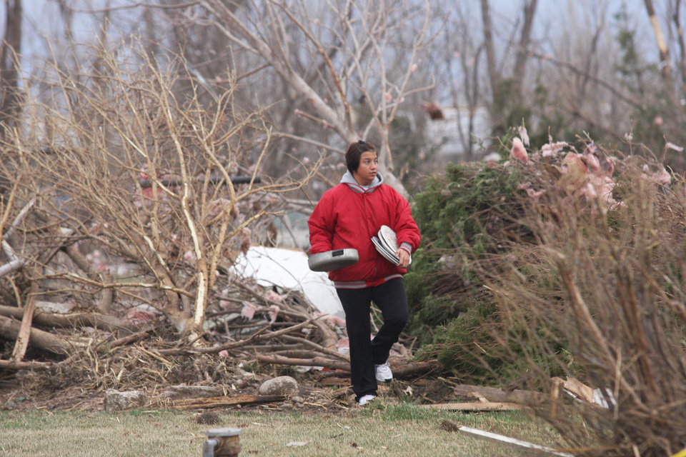 A woman retrieves items in Bailey Yard west of North Platte, Neb. after a tornado hit the area Sunday, March 18, 2012. The National Weather Service says a tornado that hit the area Sunday night was rated an EF3 on the scale that measures the strengths of such storms, with top winds of 165 mph. (AP Photo/The Telegraph, Joe Volcek)