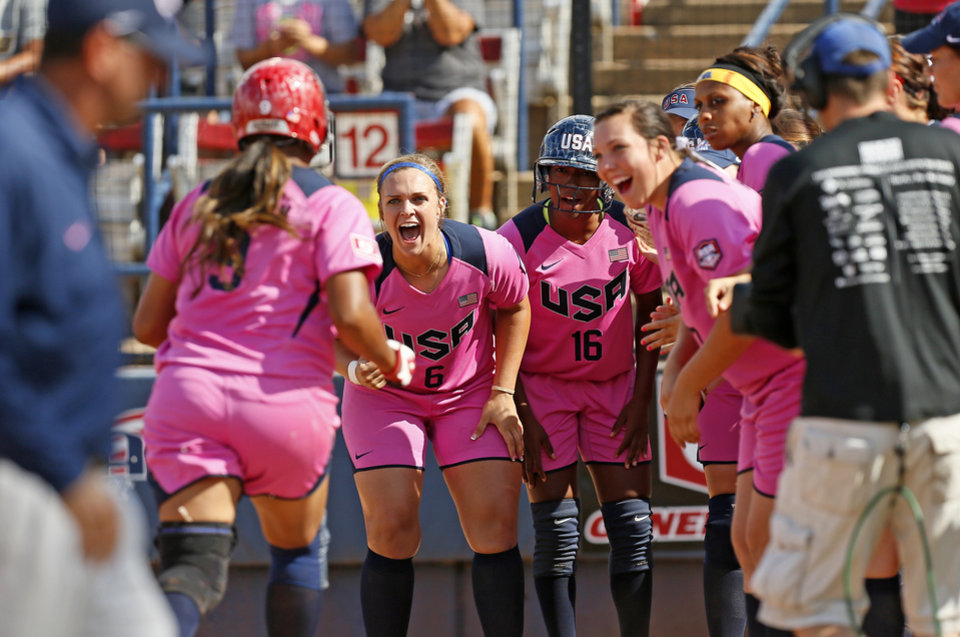 Photo - Amber Freeman (9) of the United States is greeted at home plate by her teammates after hitting a two-run home run to give the United States the lead in the third inning during a game in the World Cup of Softball between the USA and Puerto Rico at ASA Hall of Fame Stadium in Oklahoma City, Sunday, July 14, 2013. Team USA won, 10-3 in five innings. Photo by Nate Billings, The Oklahoman