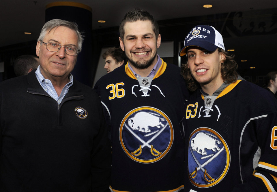 Buffalo Sabres' owner Terry Pegula, poses with Sabres right winger Patrick Kaleta (36) and left winger Tyler Ennis (63) as they greeted the fans before the NHL hockey season opener against the Philadelphia Flyers in Buffalo, N.Y., Sunday, Jan. 20, 2013. (AP Photo/Gary Wiepert)